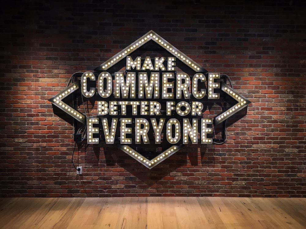 "Sign that reads ""Make commerce better for everyone"""